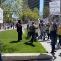 Protestors marched at the Statehouse on April 20, many carrying signs saying businesses should be able to reopen.