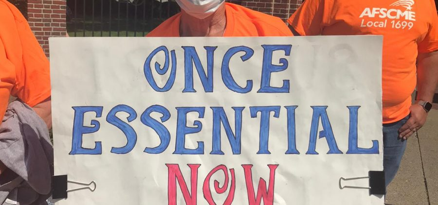 Union workers protest the layoff of 110 custodial workers at Ohio University.