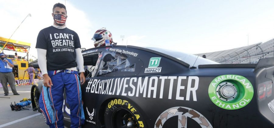 In this June 10, 2020, file photo, driver Bubba Wallace waits for the start of a NASCAR Cup Series auto race in Martinsville, Va. Bubba Wallace now counts Spike Lee and Demi Lovato – his admitted celebrity crush – as those loudly in his corner since he's become the leader of NASCAR's push for change.