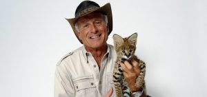 Wildlife advocate Jack Hanna poses for a portrait with a serval cub on Monday, Oct. 12, 2015 in New York