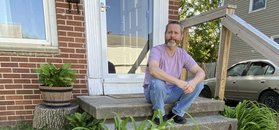 Rodney Sweigert outside his home in Columbus. The single father still hasn't received unemployment insurance for three months and sells plasma to scrape by.