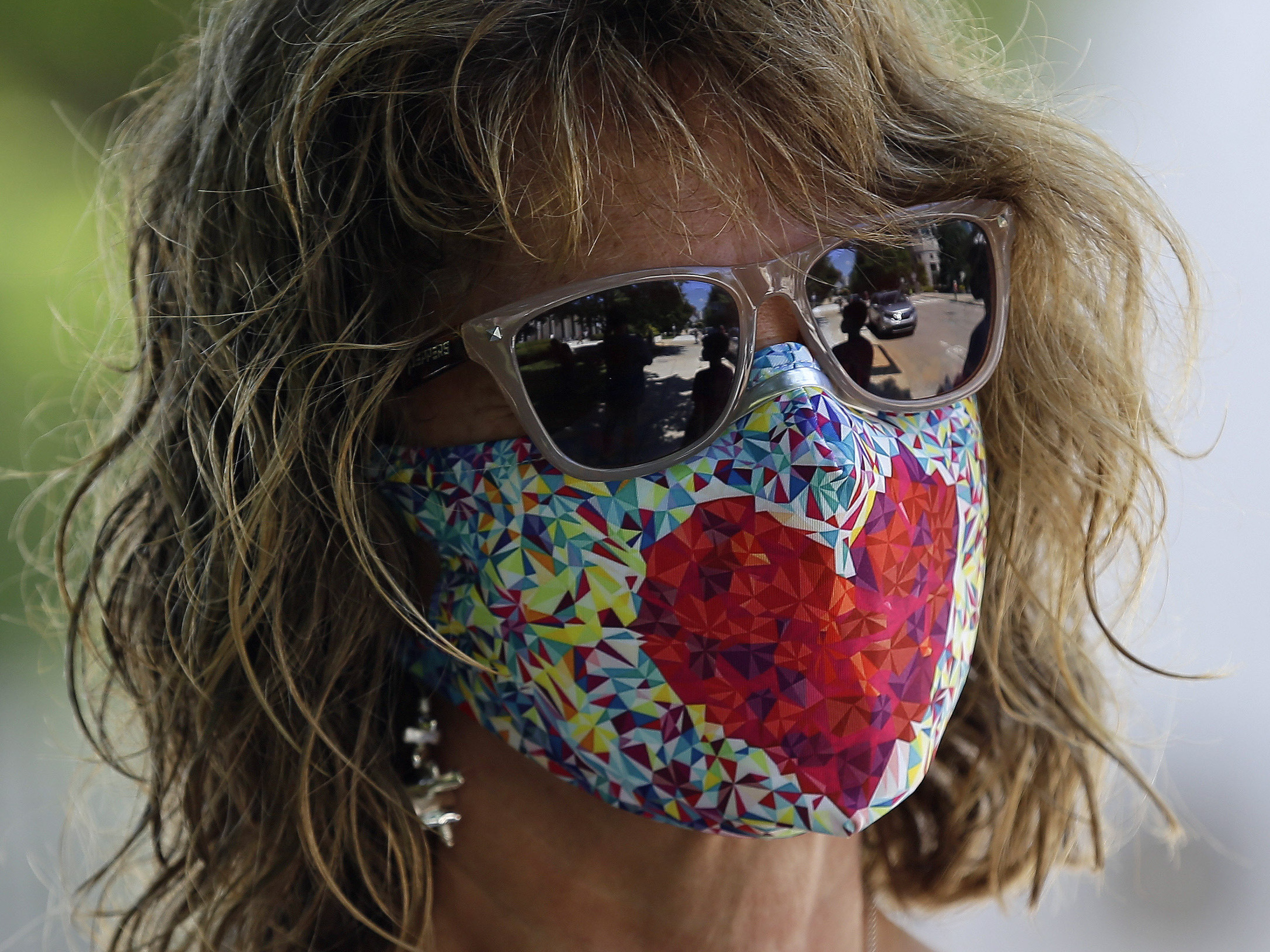 The Department of Justice has issued an alert about a card circulating online falsely claiming that holders are legally exempt from wearing a mask. Public health officials overwhelmingly recommend wearing a mask when going out in public.