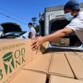 Boxes of food are loaded on vehicles last month at the Los Angeles Regional Food Bank. The country has officially entered a recession amid the pandemic, the National Bureau of Economic Research said Monday.
