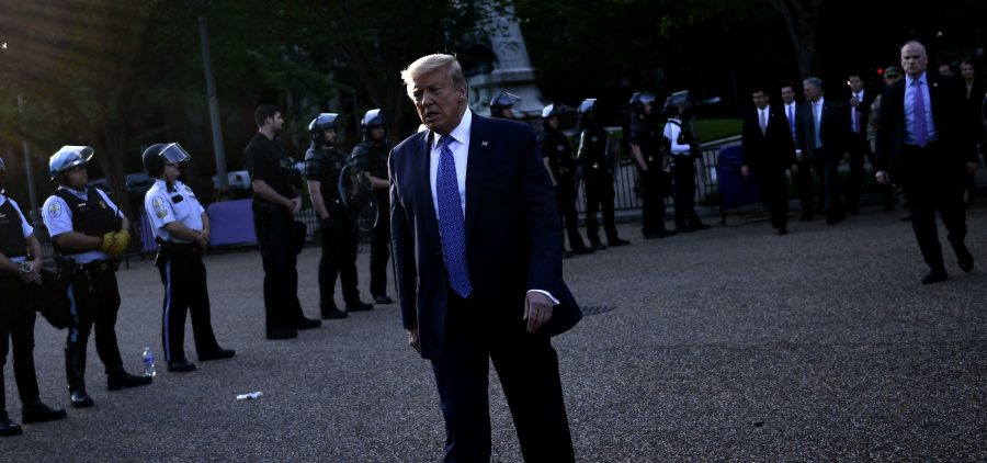 President Trump walks back to the White House escorted by the Secret Service after appearing outside of St John's Episcopal church across Lafayette Park in Washington, D.C., on Monday.