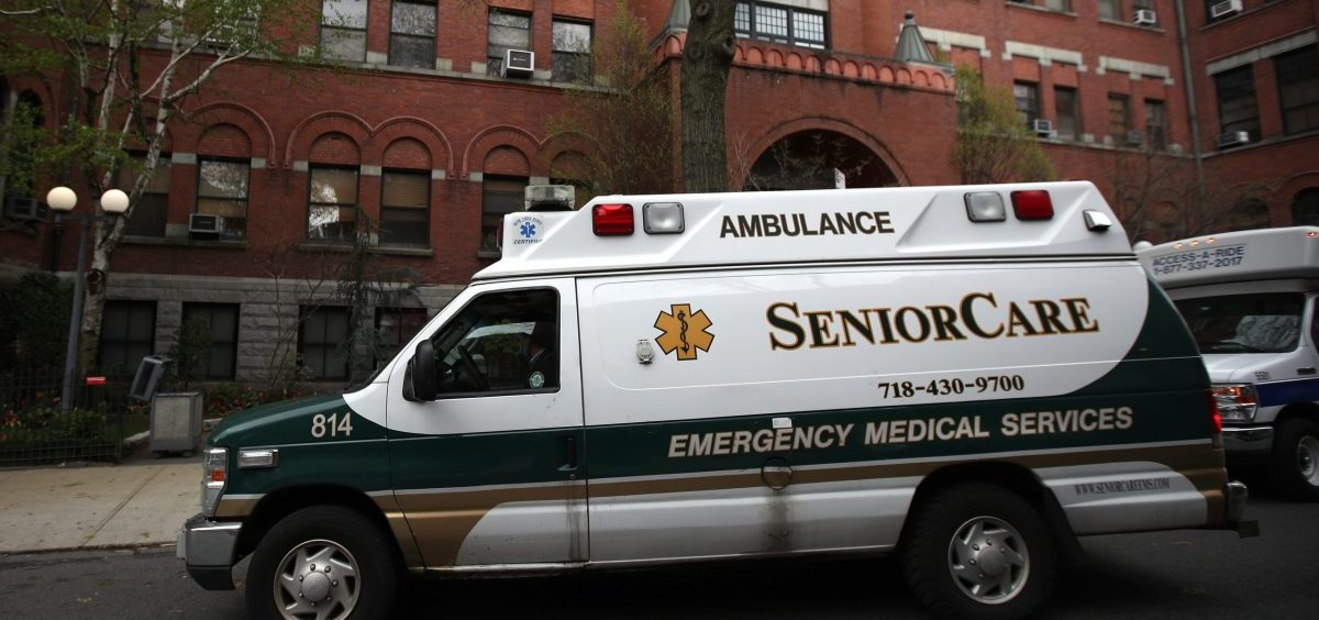 An ambulance pulls up outside a nursing home in Brooklyn, N.Y. Two members of Congress have called for an investigation of five states, including New York, which ordered nursing homes to admit patients who tested positive for COVID-19.