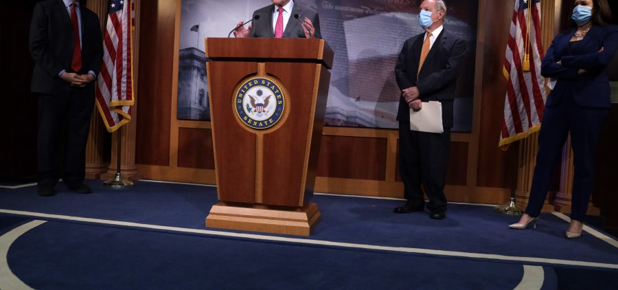 Senate Minority Leader Chuck Schumer, D-N.Y., speaks as Sen. Cory Booker, D-N.J., Senate Minority Whip Dick Durbin, D-Ill., and Sen. Kamala Harris, D-Calif., listen at a news conference criticizing GOP leaders for failing to agree to bipartisan talks on police reform. Republicans say Democrats should advance the GOP bill and propose changes.