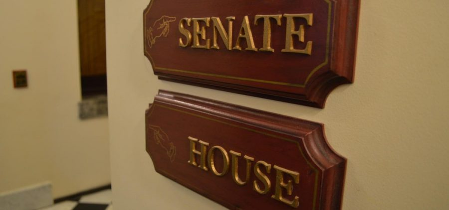 A sign in the Statehouse shows the Senate and the House directions