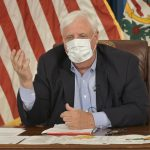 Gov. Jim Justice wears a mask during a virtual news conference in which he announced a statewide order that mandates face coverings in buildings outside of a person's home on Monday, July 6, 2020.