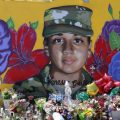 Offerings sit in front of a mural of slain Army Spc. Vanessa Guillen painted on a wall in the south side of Fort Worth, Texas, Saturday, July 11, 2020. U.S. Army officials say they will begin an independent review of the command climate at Fort Hood, examining claims and historical data of discrimination, harassment and assault, following calls for a more thorough investigation into the killing of the soldier from the Texas base.