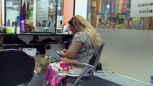 Sabine and her employees style extensions and glue on lashes while sharing rumors about government programs to legalize migrants and talking about life back home in Cameroon.