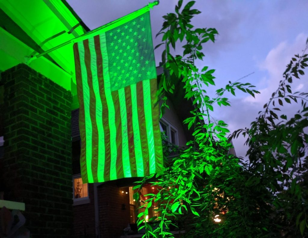 A Kentucky home displays green lights in memory of those lost to COVID-19.