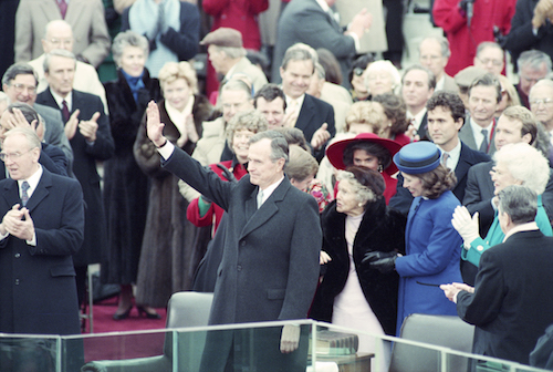 President George H. W. Bush waves after taking the oath of office, January 20, 1989