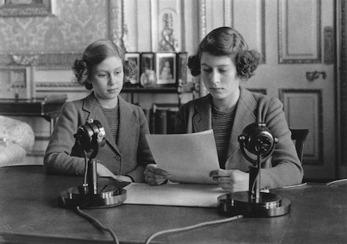Princesses Elizabeth and Margaret (1930 - 2002) making a broadcast to the children of the Empire during World War II.