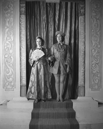 Princess Margaret (1930-2002) and Princess Elizabeth (Queen Elizabeth II), both in costume
