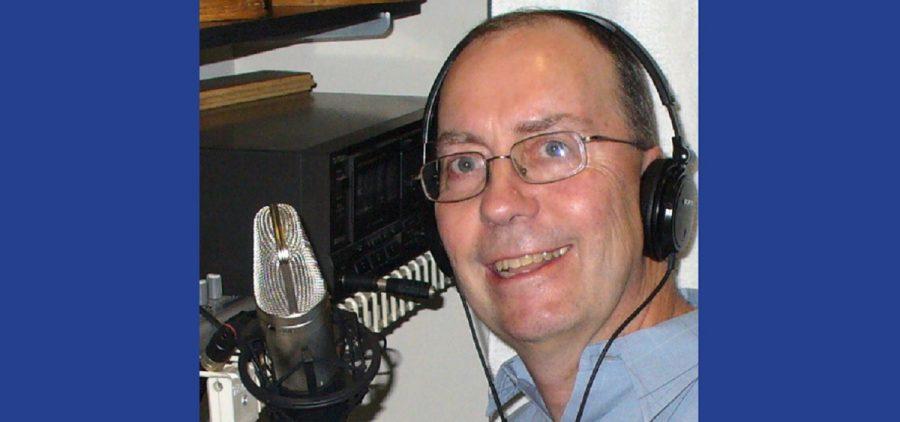 Wes Osborn headshot behind microphone