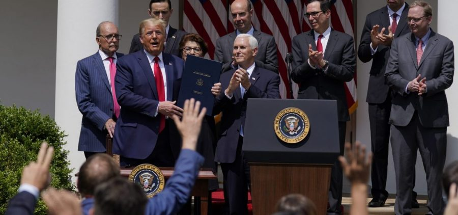President Trump, pictured June 5, signs a bill extending the time period for businesses to use funds from the Paycheck Protection Program. On Saturday he signed a bill extending the deadline to apply for the program.