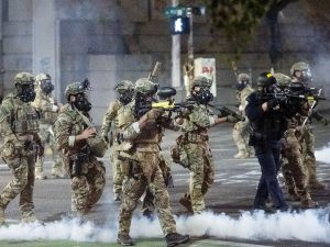 Federal agents use crowd control munitions to disperse protesters this week at the Mark O. Hatfield U.S. Courthouse in Portland, Ore.
