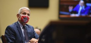 Dr. Anthony Fauci, director of the National Institute of Allergy and Infectious Diseases, listens during a House subcommittee hearing on Friday.
