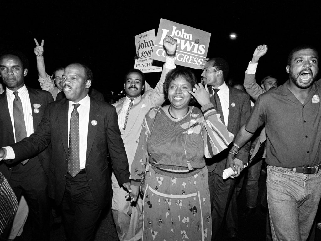 John Lewis and his wife, Lillian, lead supporters from his campaign headquarters to an Atlanta hotel for a victory party in 1986.