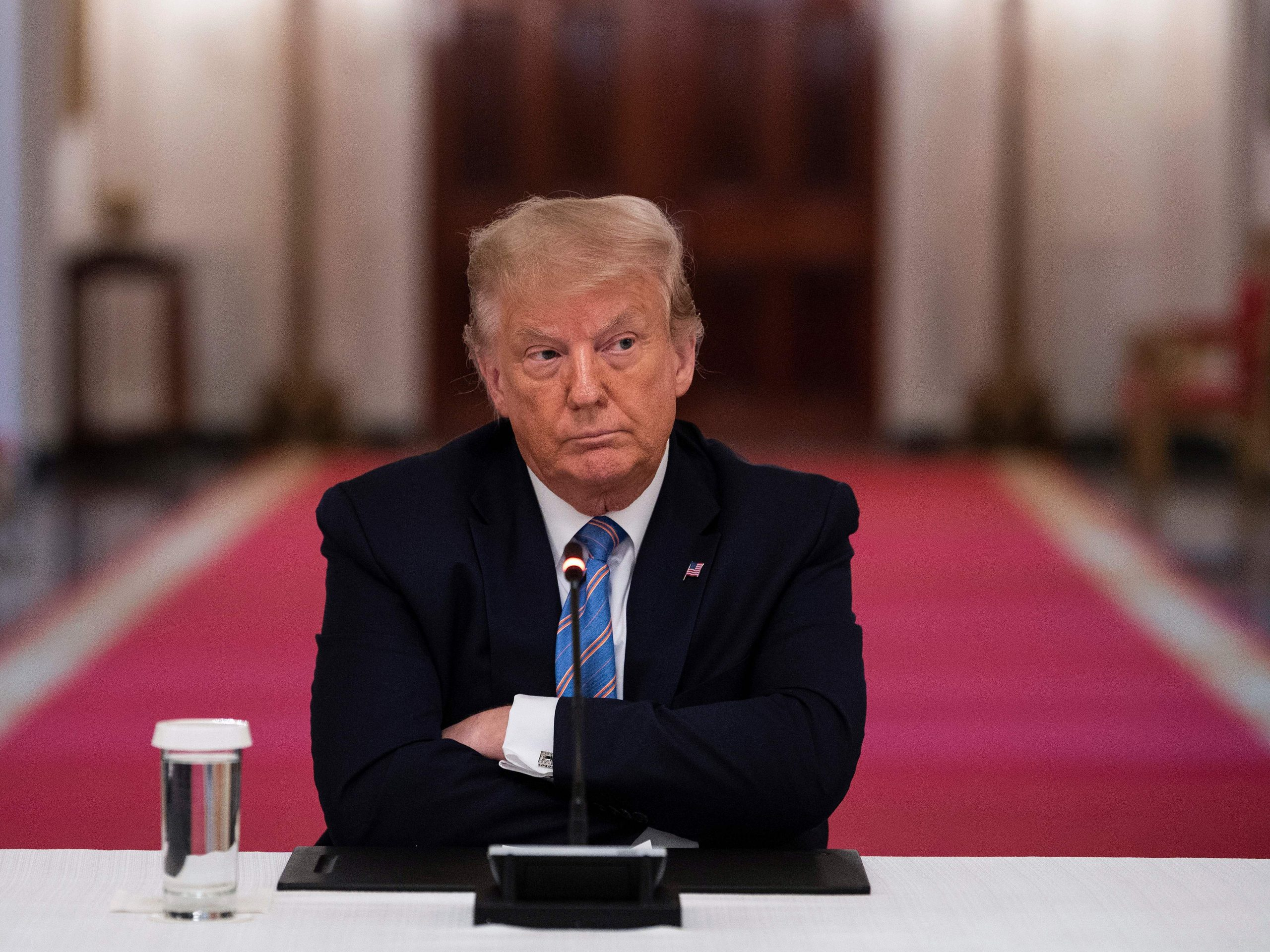 """President Trump participates in a White House event Tuesday on how to reopen schools safely. After insisting that the Republican National Convention should be in person with thousands of people, Trump said he is """"flexible"""" about the format."""