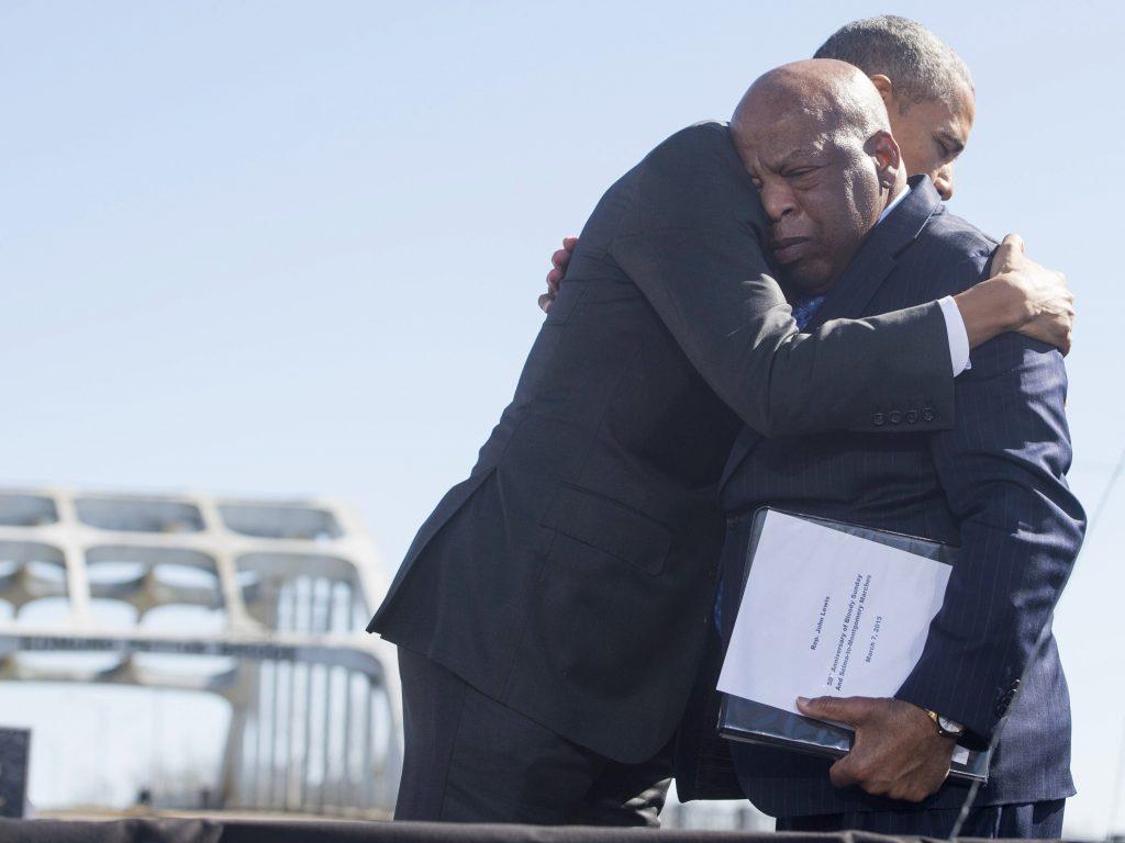 Then-President Barack Obama hugs Rep. John Lewis during a 2015 event at the Edmund Pettus Bridge in Selma, Ala., commemorating Bloody Sunday.