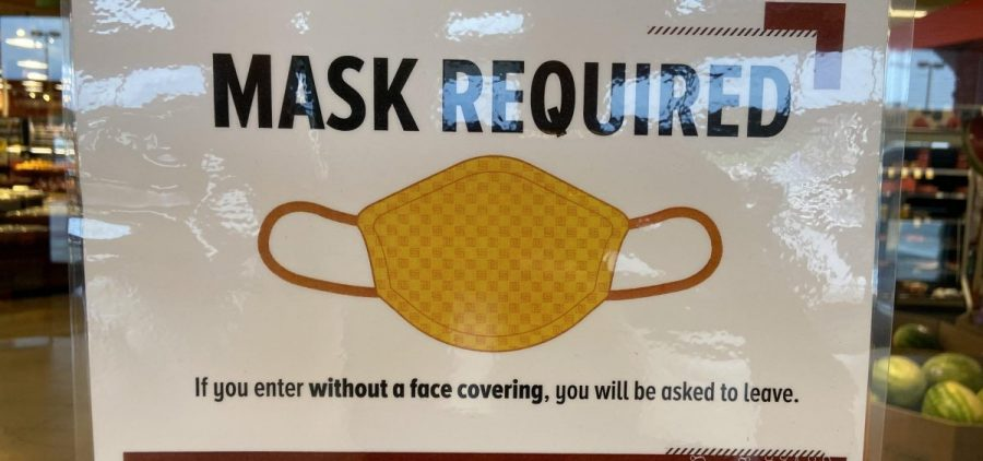 """A """"masks required"""" sign on a store in central Ohio"""