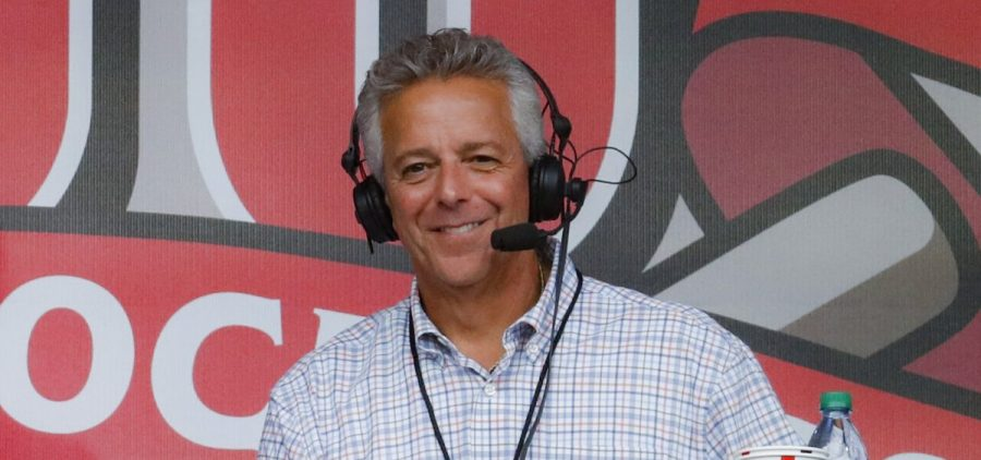 In this Sept. 25, 2019, file photo, Cincinnati Reds broadcaster Thom Brennaman sits in a special outside booth before the Reds' baseball game against the Milwaukee Brewers in Cincinnati. Brennaman used a gay slur during the broadcast of Cincinnati's game against the Kansas City Royals on Wednesday, Aug. 19, 2020. Brennaman used the slur moments after the Fox Sports Ohio broadcast returned from a commercial break before the seventh inning in the first game of a doubleheader. Brennaman did not seem to realize he was already on air.