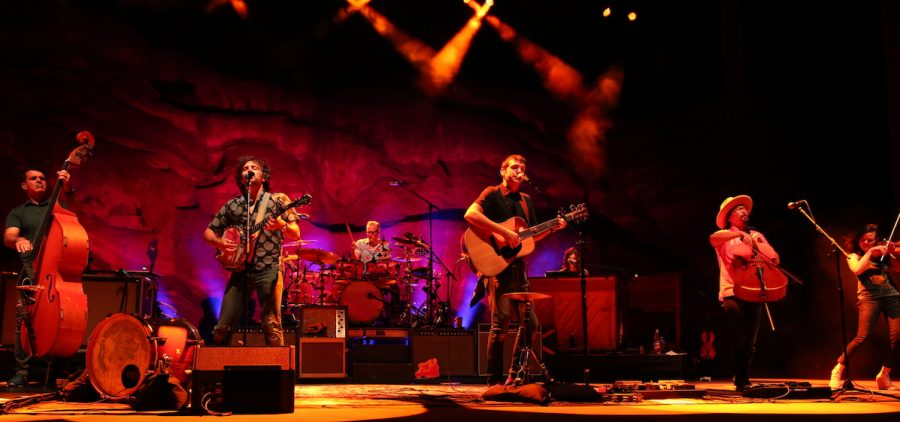 The Avett Brothers performing in the stunning natural setting of Colorado's Red Rocks Park and Amphitheatre