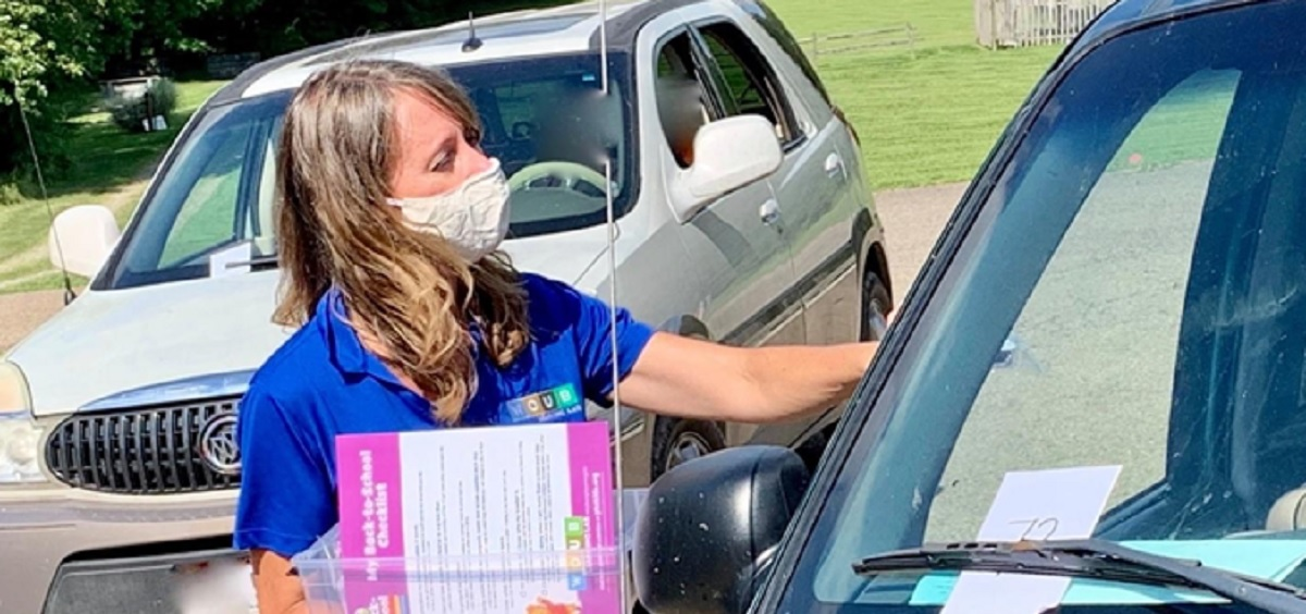 Lori Pringle handing out materials at Back to School Bash in Holmes County