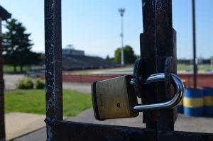 A padlock prevents access to the Gahanna High School football field.