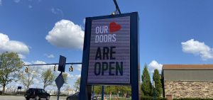 A sign at Easton Town Center in Columbus, advertising that stores, bars and restaurants are open following coronavirus closures.