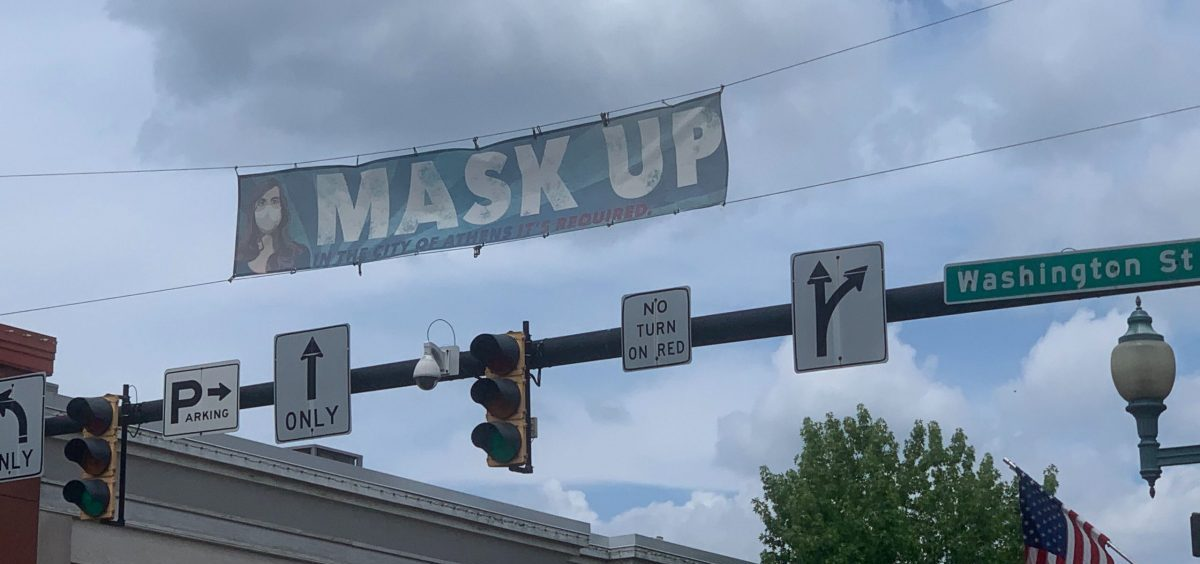 A banner over Court St. in Athens urges people to wear masks.