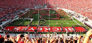 Ohio State Marching Band and Alumni Marching Band Members perform Script Ohio at an Ohio State football game