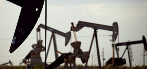 Pump jacks work in a field near Lovington, N.M., in 2015. The Trump administration is lifting an Obama-era rule aimed at limiting emissions of methane, a potent climate-warming gas.