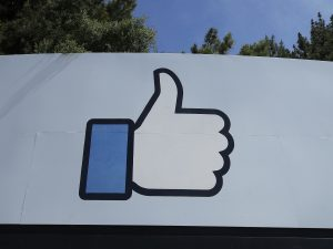"""Facebook's thumbs-up """"Like"""" logo is shown on a sign at the company's headquarters in Menlo Park, Calif."""