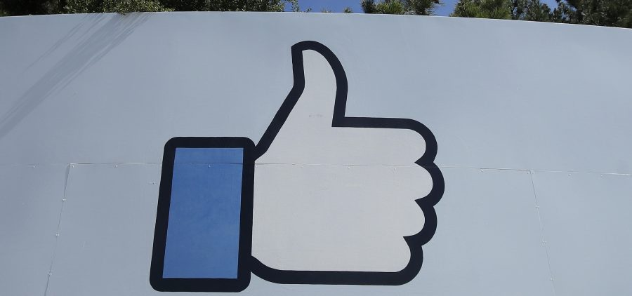 "Facebook's thumbs-up ""Like"" logo is shown on a sign at the company's headquarters in Menlo Park, Calif."