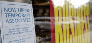 A sign advertises hiring of temporary workers at a Pier 1 store that's going out of business in Coral Gables, Fla. Last week, initial unemployment claims broke a 20-week streak of being above 1 million.