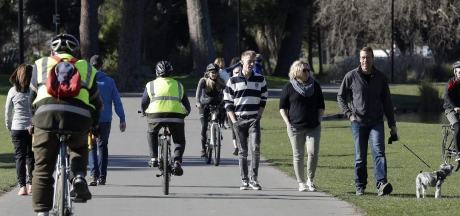 It's been 101 days since the last case of community transmission of COVID-19 in New Zealand, and life has largely returned to normal. Above: Residents exercise at Hagley Park in Christchurch on Sunday.