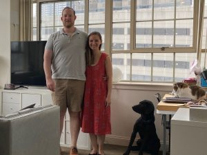 Lisa Vrooman with her boyfriend John Rock, dog Umar and cat Mochi. They love the high ceilings in their 650-square-foot apartment, but keeping it cool is costly.