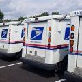 A line of USPS trucks