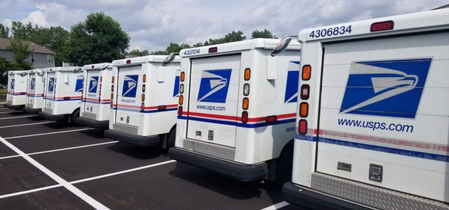A line of USPS trucks