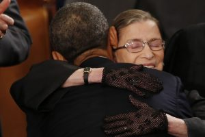Ginsburg hugs then-President Barack Obama as he arrives to deliver his State of the Union speech on Capitol Hill on Feb. 12, 2013.
