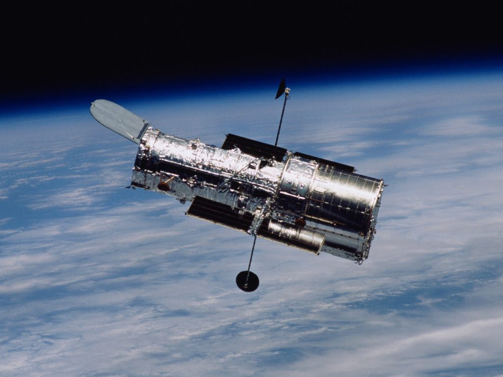 The Hubble Space Telescope floats in space after its release from the space shuttle's robotic arm following a servicing mission in March 2002.