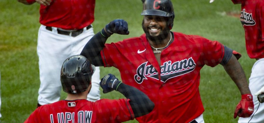 Cleveland Indians' Franmil Reyes celebrates with Cleveland Indians' Jordan Luplow (8) after hitting a three-run home run off Pittsburgh Pirates relief pitcher Geoff Hartlieb during the sixth inning of a baseball game in Cleveland, Sunday, Sept. 27, 2020. The Indians won the game 8-6.