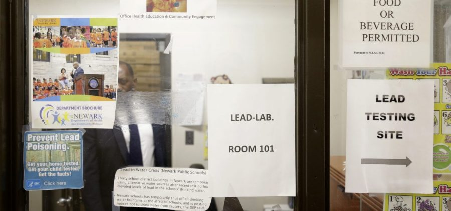 Signs about lead poisoning are posted in the Newark Health Department in Newark, N.J., Wednesday, Aug. 14, 2019.
