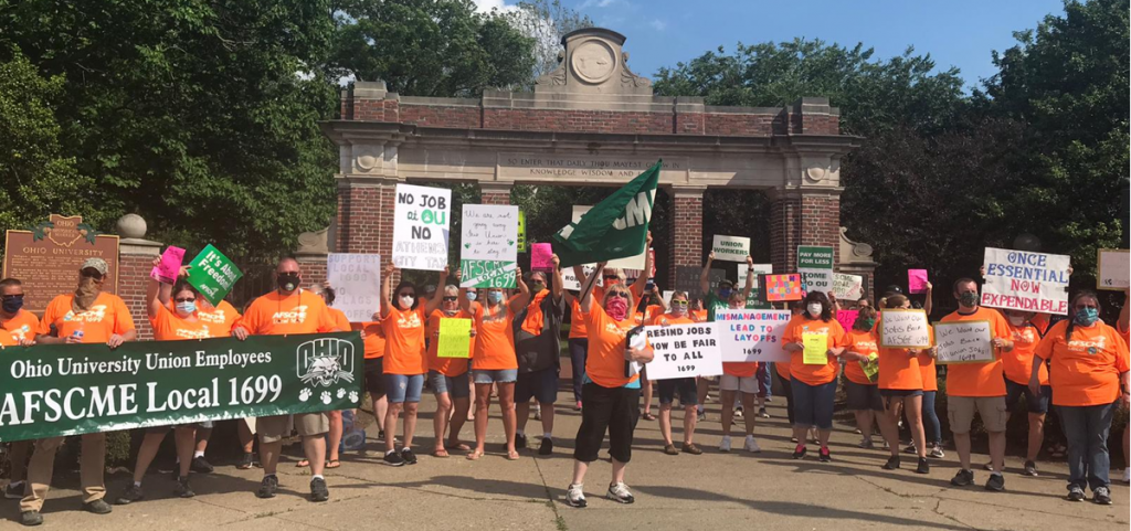 Union workers at Ohio University and supporters demand job cuts be reversed at a protest in June.