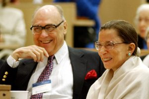 Ginsburg and her husband, Marty, listen to Justice Stephen Breyer speak at Columbia Law School in 2003.