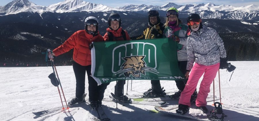Beagle and family holding Ohio University flag