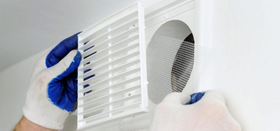 An installer fixes an air vent