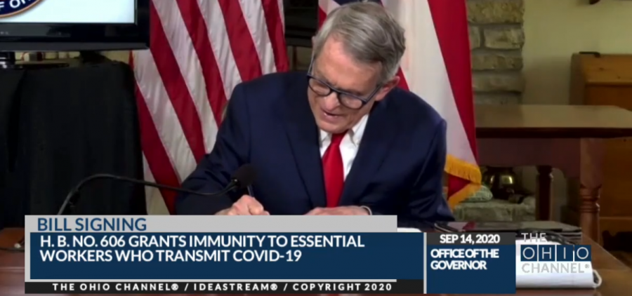 Gov. Mike DeWine signs House Bill 606 in a virtual signing ceremony from his home in Cedarville. Lt. Gov. Jon Husted was in his Columbus office, and Speaker Bob Cupp (R-Lima) and Senate President Larry Obhof (R-Medina) joined from their homes.